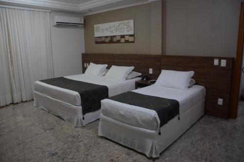 Cama ou camas em um quarto em Mavil Plaza Hotel