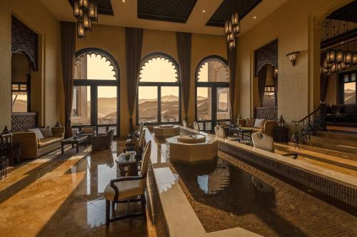 The lounge or bar area at Anantara Qasr al Sarab Desert Resort