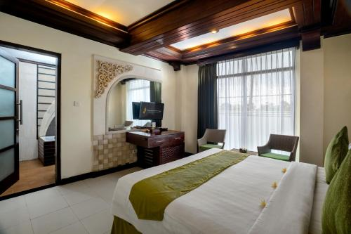 A bed or beds in a room at The Bali Dream Villa & Resort Echo Beach Canggu