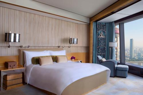 A bed or beds in a room at The Ritz-Carlton Shanghai, Pudong