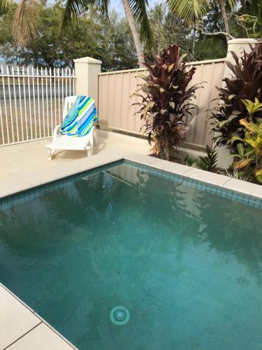 The swimming pool at or near 67 Casuarina Beachhouse
