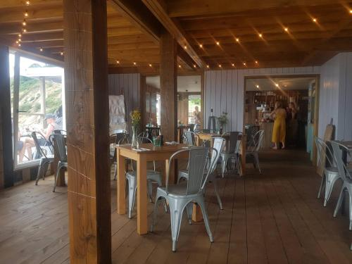 A restaurant or other place to eat at Millendreath Beach Resort