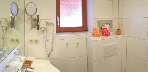 Ein Badezimmer in der Unterkunft BIO Sportpension