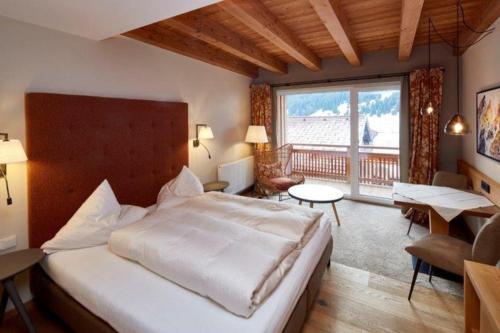 Ein Bett oder Betten in einem Zimmer der Unterkunft Alpenjuwel Rohnenspitze