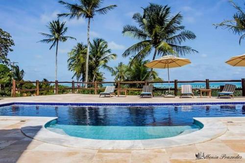 The swimming pool at or close to Pousada Villa das Palmeiras