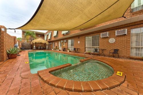 The swimming pool at or near Central Yarrawonga Motor Inn