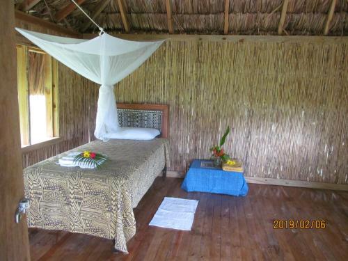 Cama o camas de una habitación en Palmlea Farms Lodge & Bures - Villas
