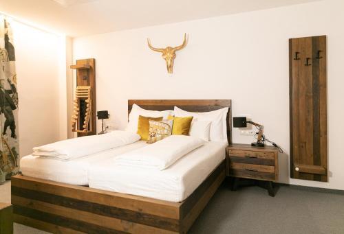 Ein Bett oder Betten in einem Zimmer der Unterkunft Sporthotel Igls