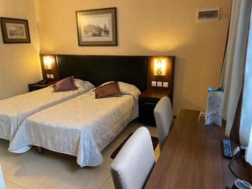 A bed or beds in a room at Grand Harbour Hotel