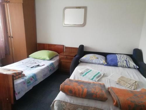 Кровать или кровати в номере Гостевой Дом Простор
