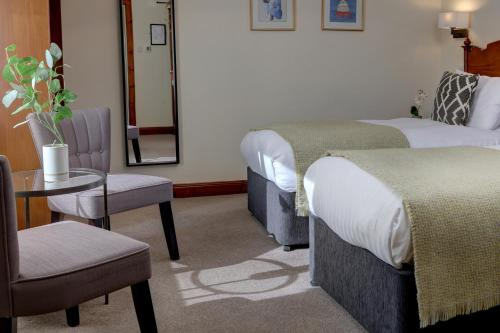 A bed or beds in a room at BEST WESTERN The Crianlarich Hotel