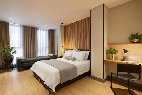 A bed or beds in a room at 14 Urban Hotel