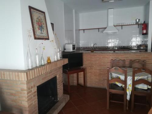 A kitchen or kitchenette at Hospederia y Aptos Casa de las Piedras