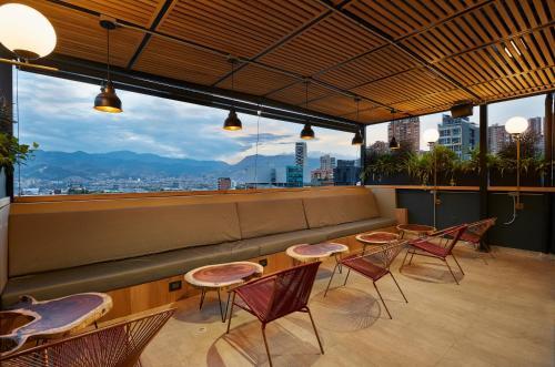 A balcony or terrace at 14 Urban Hotel