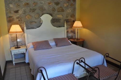 A bed or beds in a room at La Casa del tío Americano