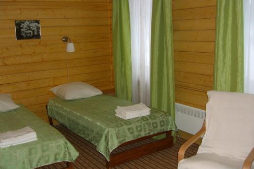 Кровать или кровати в номере Отель Вегарус