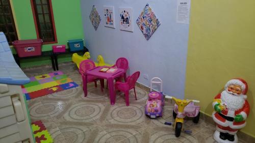 Clube infantil em Pousada Ferradura Beach