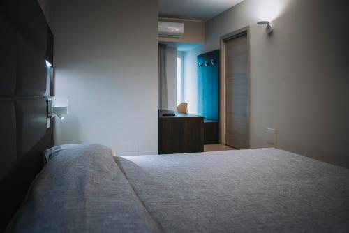 Letto o letti in una camera di Hotel Casale dei Greci