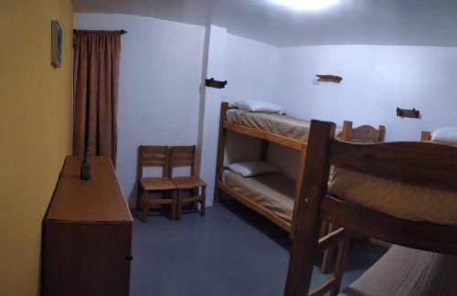 Una cama o camas cuchetas en una habitación  de ALMA Travelers