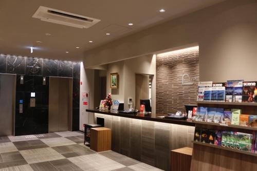 The lobby or reception area at PORTA INN bentencho