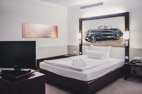 A bed or beds in a room at Abacco Hotel