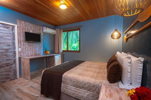 Cama ou camas em um quarto em Village Paraíso Tropical
