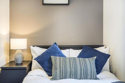 Un ou plusieurs lits dans un hébergement de l'établissement YKP Apartments - Mornington Crescent