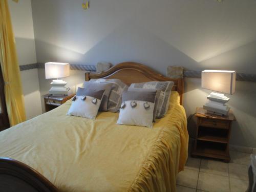Un ou plusieurs lits dans un hébergement de l'établissement Ferme Auberge Du Vieux Puits
