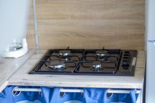 A kitchen or kitchenette at Maison d'hôtes L'îlot bambou