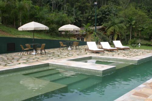 The swimming pool at or near Pousada Vilarejo do Quim