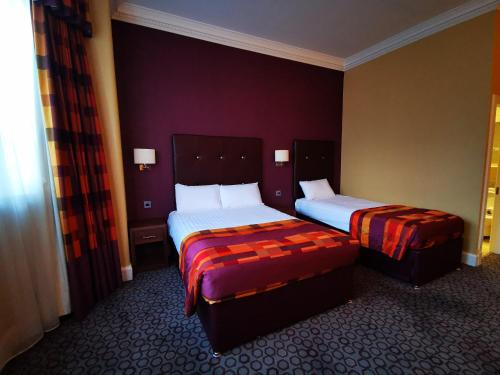 A bed or beds in a room at Frederick House Hotel