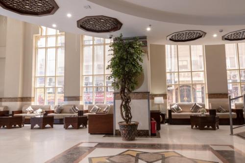 Um restaurante ou outro lugar para comer em ضيافة الرجاء - Al-Raja Hotel