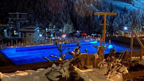 The swimming pool at or near Dolasilla Mountain Panoramic Wellness Hotel