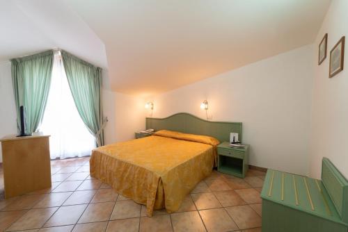 Cama o camas de una habitación en Hotel Il Ceppo
