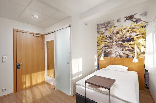 A bed or beds in a room at Icelandair Hotel Reykjavik Marina