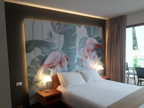 A bed or beds in a room at La Vela Boutique Hotel