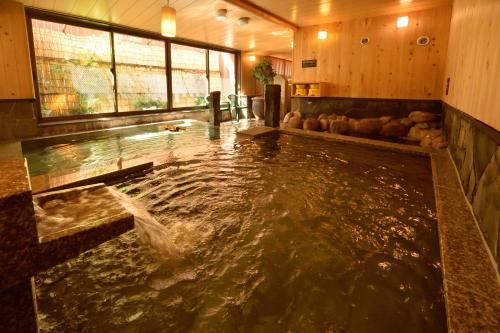 The swimming pool at or near Dormy Inn Sapporo Annex