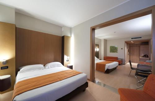 A bed or beds in a room at THotel Lamezia