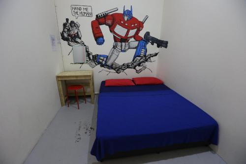 A bed or beds in a room at Hero Hostel Kuching