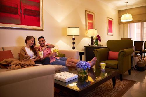 منطقة جلوس في ميركيور للشقق الفندقية دبي برشا هايتس