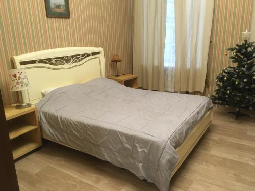 Кровать или кровати в номере Aparts hub palace