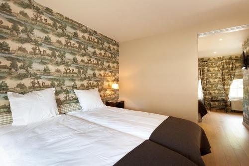 Een bed of bedden in een kamer bij Logies Noorderlicht