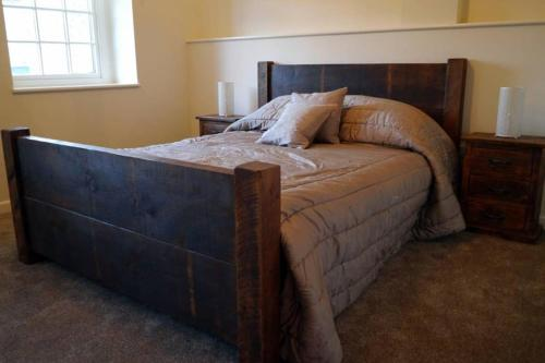 A bed or beds in a room at The Den