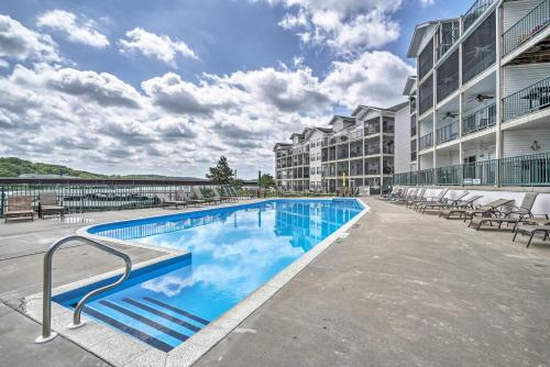The swimming pool at or near Lakefront Camdenton Condo with Deck, Shared Pool