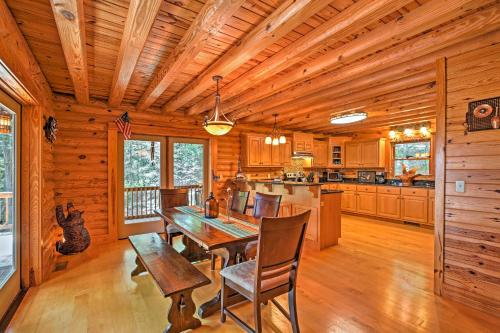 A restaurant or other place to eat at Large Lavonia Lakefront Log Cabin with Boat Slip