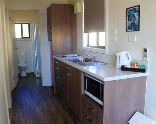 A kitchen or kitchenette at BIG4 Hobart Airport Tourist Park