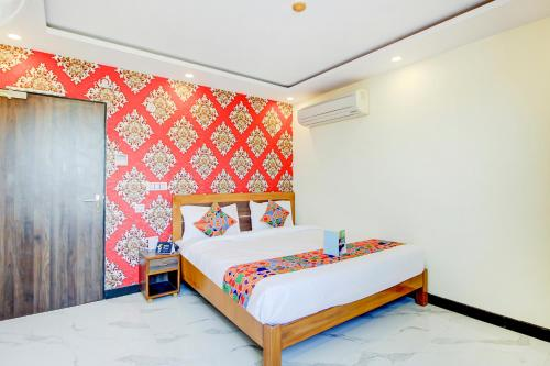 A bed or beds in a room at Jasoda Heritage Hotel by Keshav Global