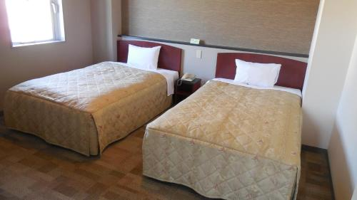 A bed or beds in a room at Kuretake Inn Gotemba Inter Gold Cabin