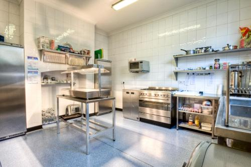 A kitchen or kitchenette at Tower House Executive Guest House