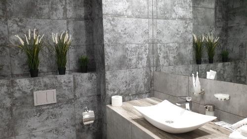 Ванная комната в Orange Hotel